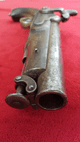 A mid Victorian period British military percussion Coastguard pistol. Lock Marked with a Crown over V.R. Ref 9222.